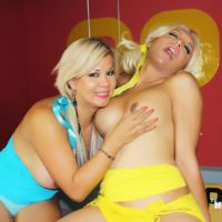 Blonde shemale Naomi Chi and trans girlfriend tongue kiss while jerking cock