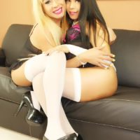 Blonde shemale Tania Q getting blowjob from TS girlfriend in white stockings
