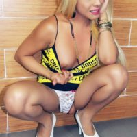 Hot blonde shemale Tania Q revealing firm tits while flashing upskirt underwear
