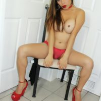 Leggy brunette tranny Nina Stronghold loosing big boobs and shecock from dress