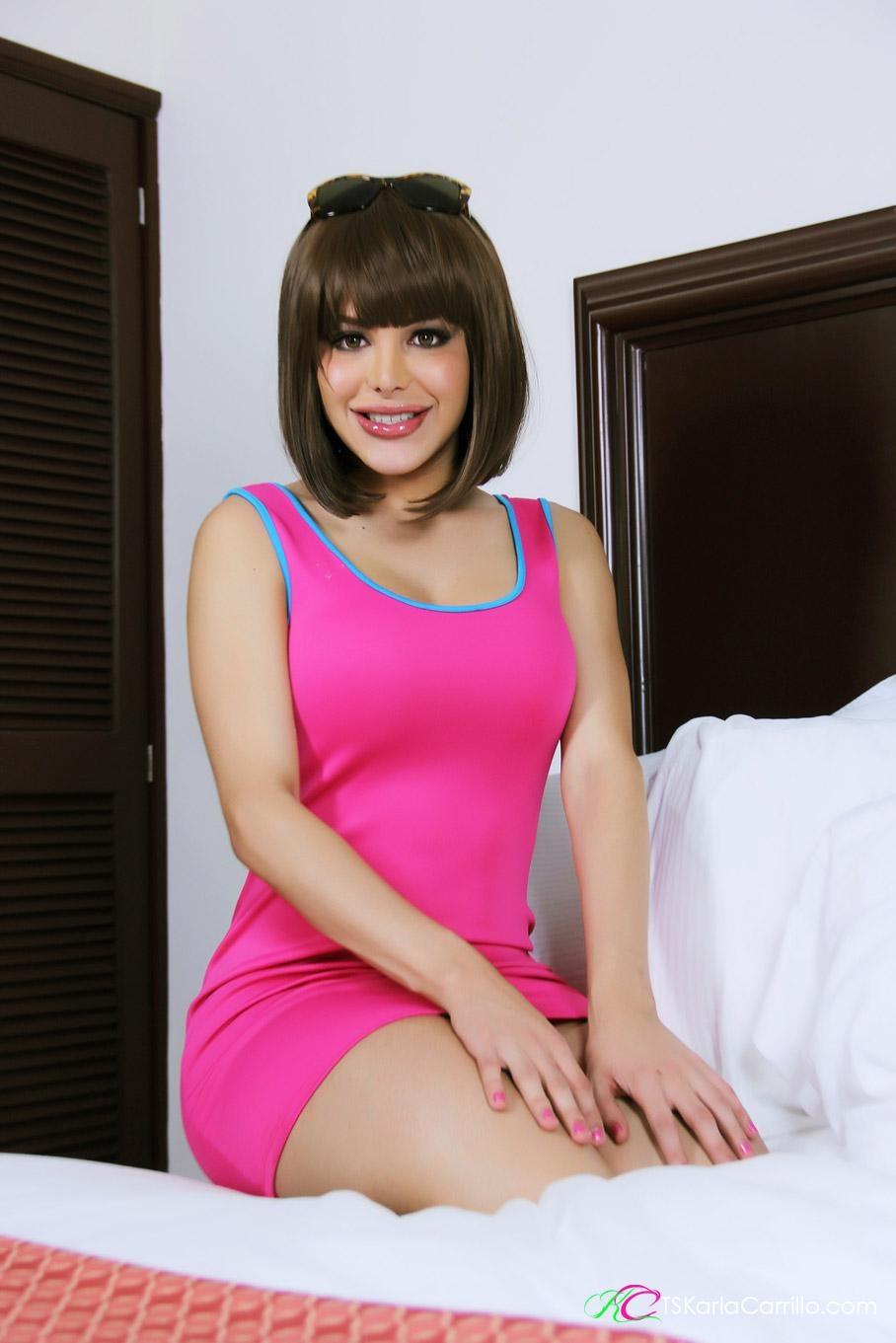 Petite shemale pornstar Karla Carrillo baring large tits before jerking off massive cock