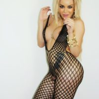 Sexy Latina shemale Karla Carrillo flaunting big boobs in mesh bodystocking
