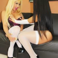 Shemale Tania Q and trans girlfriend humping and giving oral sex in white stockings