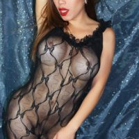 Solo trans model Nina Stronghold letting big boobs loose from sheer bodystocking