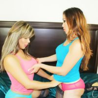 TS pornstar Nina Stronghold and trans girlfriend undress for oral sex in stockings