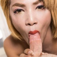 Redhead ladyboy Ning 2 licking man's asshole while giving a BJ wearing bodystocking