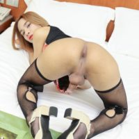 Ladyboy Benty hikes up her dress before bareback anal sex with a man