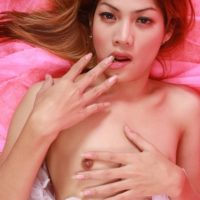 Skinny Asian ladyboy Tong bares her tiny tits before inserting sex toy in her asshole