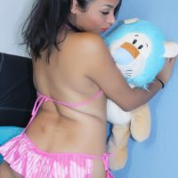 Asian ladyboy Tiara Tiramisu holds her plush toy while masturbating in pigtails