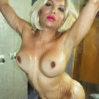 Naked shemale Percy Princess jerks off her big cock while taking a shower