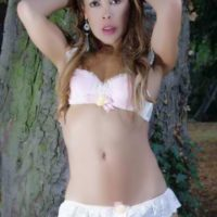 Solo model Nicole Big Caliber whips out her huge cock in the woods