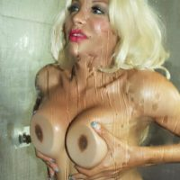 Solo shemale Percy Princess presses her big boobs up against shower stall