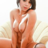 Teen ladyboy Bam takes off her black dress and changes into hot red lingerie
