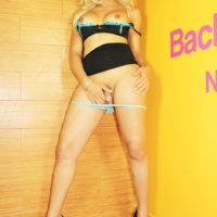 Blonde shemale Percy Princess hikes her black skirt and pulls down panties to masturbate