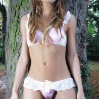 Hot trans model Nicole Big Caliber shows off her hard cock in sensual lingerie outdoors