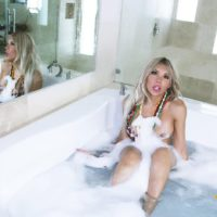 Solo shemale Percy Princess shows her big tits while taking a bubble bath