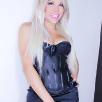Beautiful shemale with blonde hair Percy Princess models in black lingerie and nylons