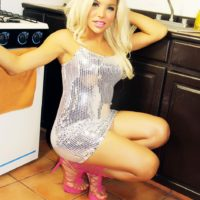 Sexy blonde shemale Percy Princess exposes her big butt during solo action in kitchen