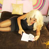 Blonde shemale Percy Princess pulls down her pantyhose to masturbate on her bed