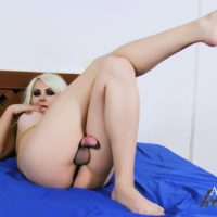 Blonde tranny Afrika Kampos frees her tits and shecock from bra and panty ensemble