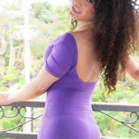 Fully clothed teen tranny Keira Verga models on the balcony in a tight dress