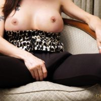 Gorgeous shemale Mariana Cordoba sets her nice tits and big cock loose on a chair