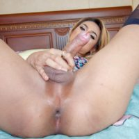 Ladyboy Numing and a man cross swords during POV action on a bed