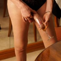 Leggy tranny Mariana Cordoba sticks her massive cock inside a glass afore a mirror