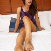 Petite ladyboy Manaw shows her pretty feet during POV sex with a man on a bed