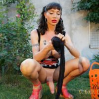Solo shemale Mariana Cordoba lets her monster cock hang loose out in the backyard