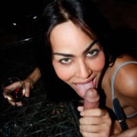 Asian transsexual Lanta and a Ladyboy Gold model lick a man's cock together