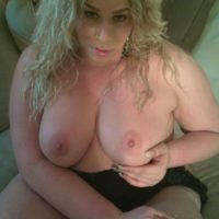 BBW shemale Monica Richard frees her big tits from a dress before masturbating