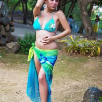 Beautiful ladyboy Sapphire Young wanders outdoors in a bikini and a sarong