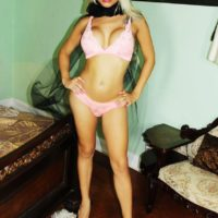 Blonde trans babe Angeles Cid sets her big tits free of her bra in matching panties