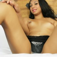 Cute ladyboy Tiara Tiramisu takes off her lingerie before jerking her cock on a bed