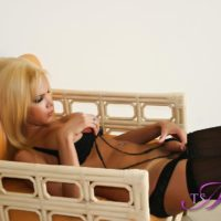 Hot blonde tranny Milla Viasotti plays with her dick while showing her bare ass