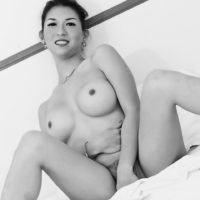 Japanese ladyboy Sapphire Young uncovers her big tits before stroking her hard cock
