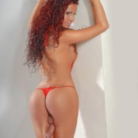 Redhead trans model Blondie Johnson shows her hard cock in swimwear and bare feet