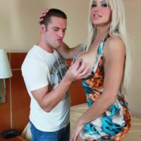 Tall blonde TS Azeneth has her big tits bared by a man before he pinches her nipples