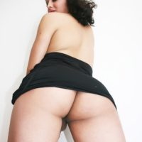 Teen shemale Keira Verga frees her phat ass and cock from a little black dress