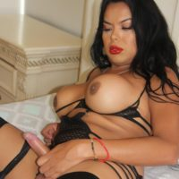 Thick and busty Latina shemale Barbie Blush jerks her dick while playing with a sex toy