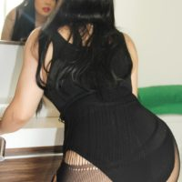 Thick Latina tranny Sina Latina releases her firm tits from a sexy bodystocking