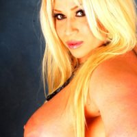 Blonde BBW shemale Monica Richard sets her enhanced breasts free in solo action