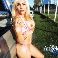 Fit blonde shemale Angeles Cid free her big tits from sports bra in a public place