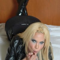 Hot blonde tranny Milla Viasotti sets her big tits free in a leather jacket and boots