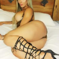 Hot blonde tranny Nelly Ochoa bares her big tits before stroking her massive dick