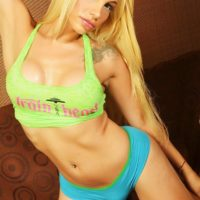 Hot blonde trans model Angeles Cid strikes great non nude poses in fitness attire