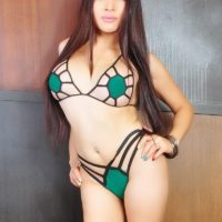 Asian ladyboy Vitress Tamayo frees her big tits and large cock from a sexy bikini