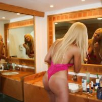 Blonde trans girl Milla Viasotti releases her big boobs from hot pink lingerie