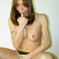 Busty Tgirl Mariana Cordoba sucks a finger while loosing her huge cock from panties